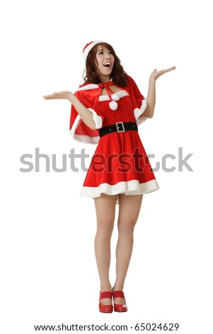 Surprised Christmas girl, full length portrait isolated on white background. - stock photo
