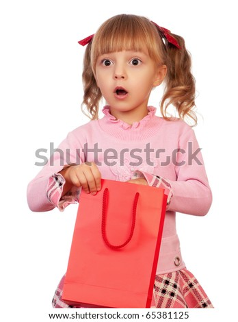 Surprised christmas girl holding shopping bag. Isolated on white background. - stock photo