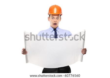 Surprised construction worker looking at project papers isolated against white background - stock photo