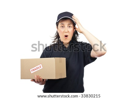 Surprised courier woman holding a package fragile on white background - stock photo