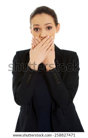Surprised excited young business woman covering her mouth. - stock photo