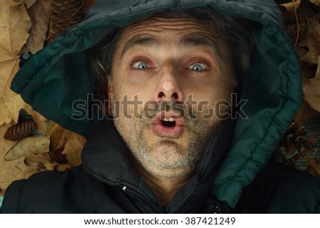 surprised expression middle-aged man wearing a hood
