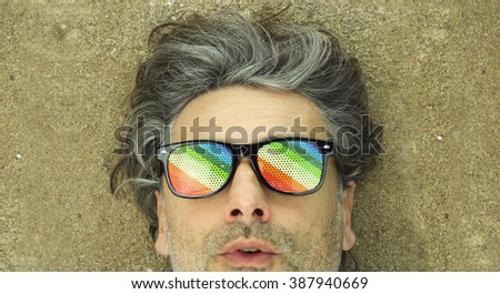 surprised expression middle-aged man wearing rainbow sunglasses
