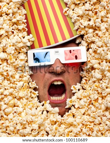Surprised face in popcorn with bucket on head watching 3D movie - stock photo