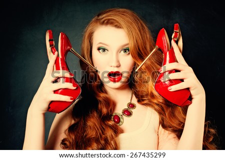 Surprised Fashion Woman with red shoes. Beautiful Girl opening Mouth. Hairstyle. Makeup. Sale and Gifts concept - stock photo