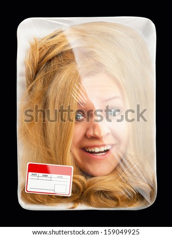 Surprised female head wrapped in food tray. Isolated on black - stock photo