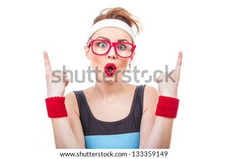 Surprised fitness woman gesturing finger up, funny sport girl have idea - stock photo