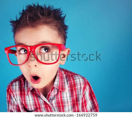 Surprised five years old boy wearing glasses - stock photo
