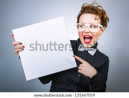 Surprised formal woman holding white empty board - stock photo
