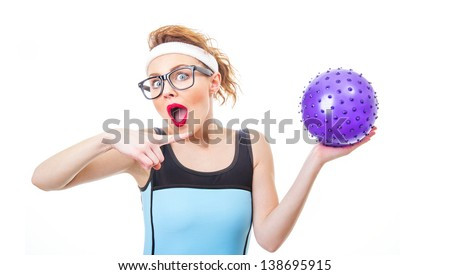 Surprised funny woman with rubber ball ready for playing, isolate on white - stock photo
