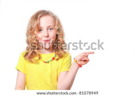 surprised Girl child pointing to blank copy space (your product) - stock photo