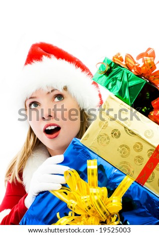 surprised girl dressed as Santa with a lot of Christmas presents - stock photo