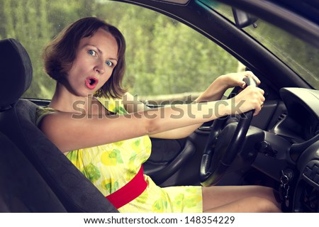 Surprised girl driving