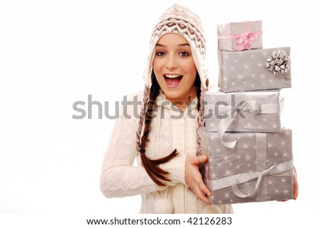 Surprised girl holding stack of presents on white background - stock photo