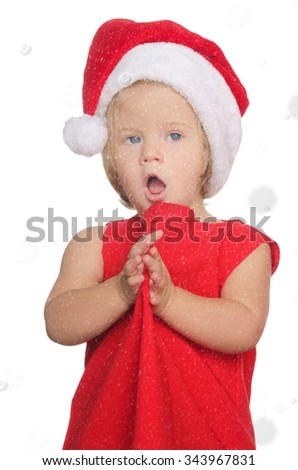 surprised girl in christmas cap in snow isolated on white - stock photo