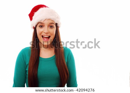 Surprised girl in santa hat on white background - stock photo