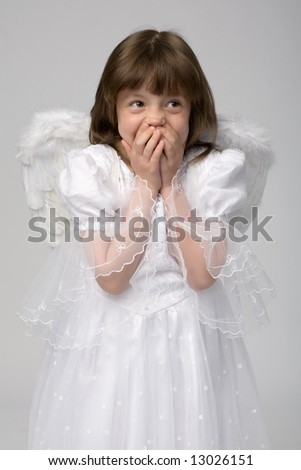 surprised girl in white dress with angel wings
