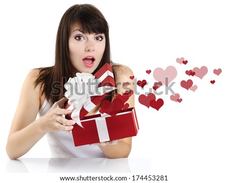 surprised girl opening a red gift box with heart