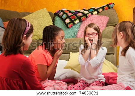 Surprised group of little girls at a sleepover - stock photo