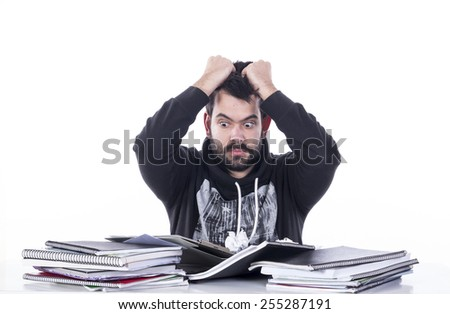 Surprised guy on table - stock photo
