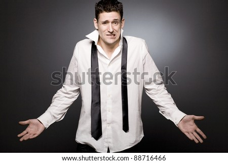 Surprised handsome young businessman in white shirt.