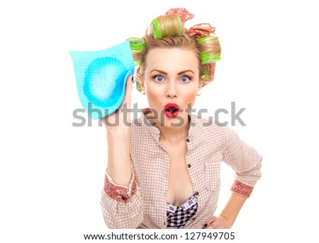 surprised housewife holding rag / wipe with foam / soap isolated on white. Pin-up girl