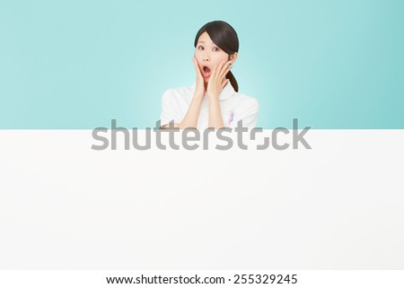 surprised Japanese nurse with Bulletin Board - stock photo