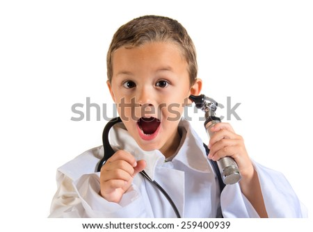 Surprised kid dressed like doctor holding an otoscope - stock photo