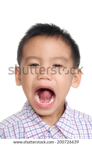 surprised little boy isolated on white background - stock photo