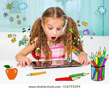 Surprised little girl and her magic tablet - stock photo
