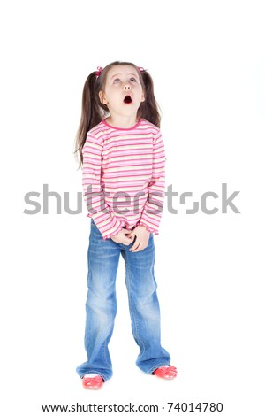 Surprised little girl looking up - stock photo