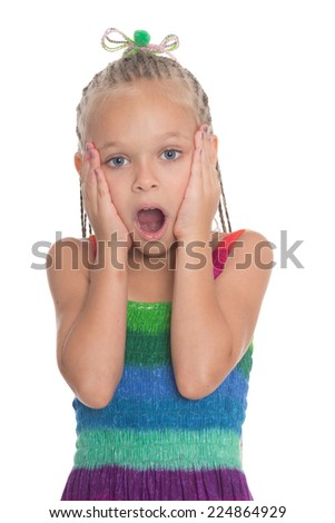 Surprised little girl of six years on a white background. - stock photo