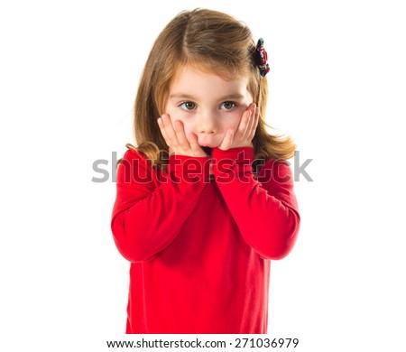Surprised little girl over white - stock photo