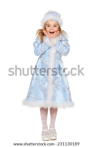 Surprised little girl wearing blue suit of snow maiden standing in full length, over white background