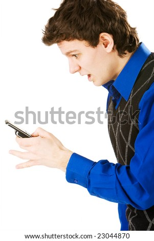 Surprised man holding a cellphone and reading sms