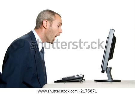 surprised man in blue suit in front of computer