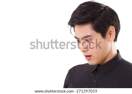 surprised man looking down to blank space - stock photo