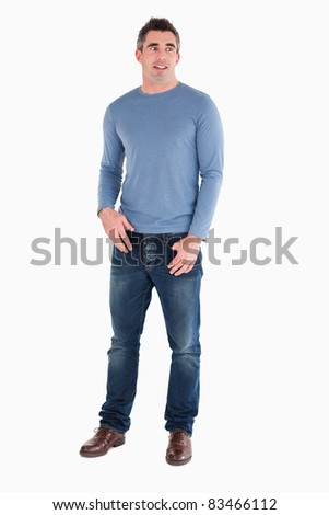Surprised man posing against a white background - stock photo