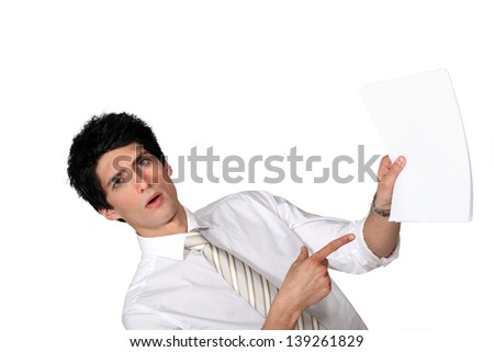 Surprised man showing a document - stock photo