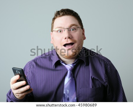 surprised man with mobile phone - stock photo