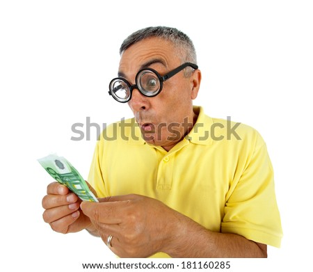 Surprised man with money and WOW expression on white backgound.
