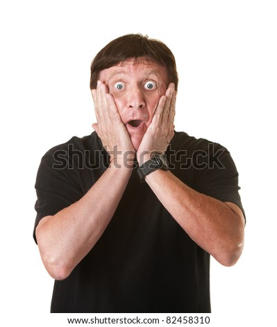 Surprised mature Caucasian man holds his head over white background