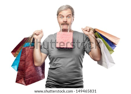 surprised mature man holding shopping bags isolated on white background
