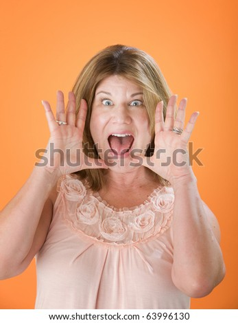 Surprised Mature Woman with Hands Near her Face