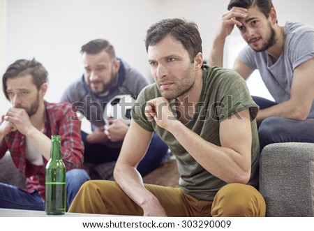 Surprised men after the soccer match - stock photo