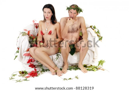 surprised naked kitsch couple sitting on couch - stock photo