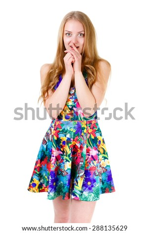 Surprised of young pretty blonde teenager with wide open eyes standing and holding hands near her lips. Isolated on white background, human emotion, facial expression - stock photo