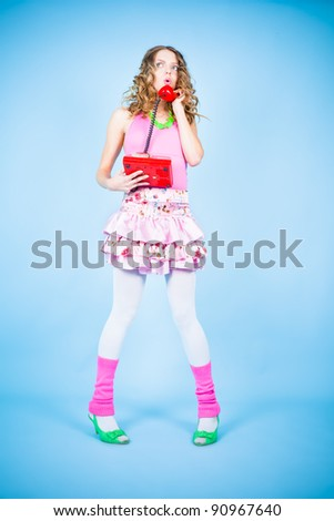 Surprised pin-up woman calling by retro phone - stock photo