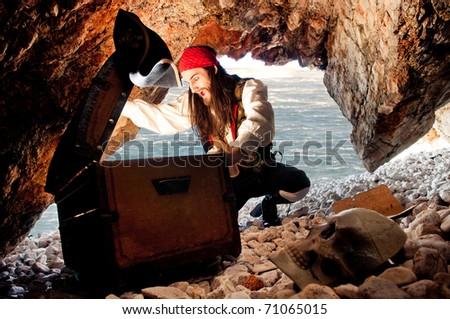 Surprised pirate opens treasure chest - stock photo