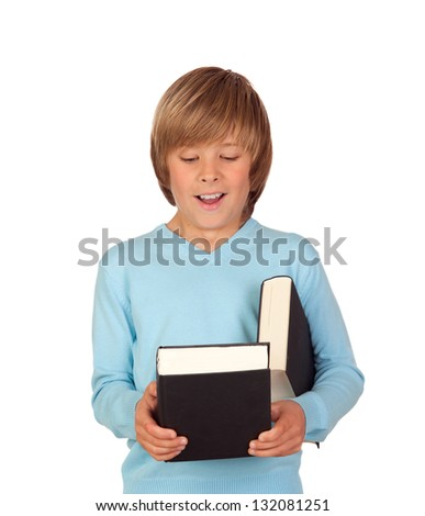 Surprised preteen boy with a book isolated on a white background - stock photo